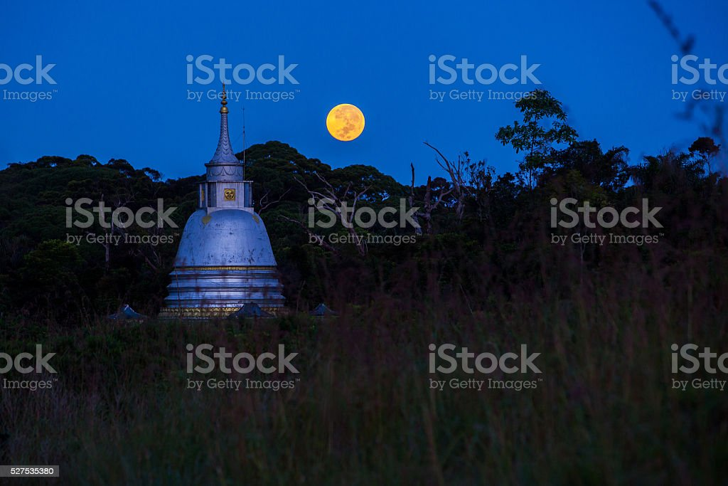 Buddhist temple and full moon stock photo