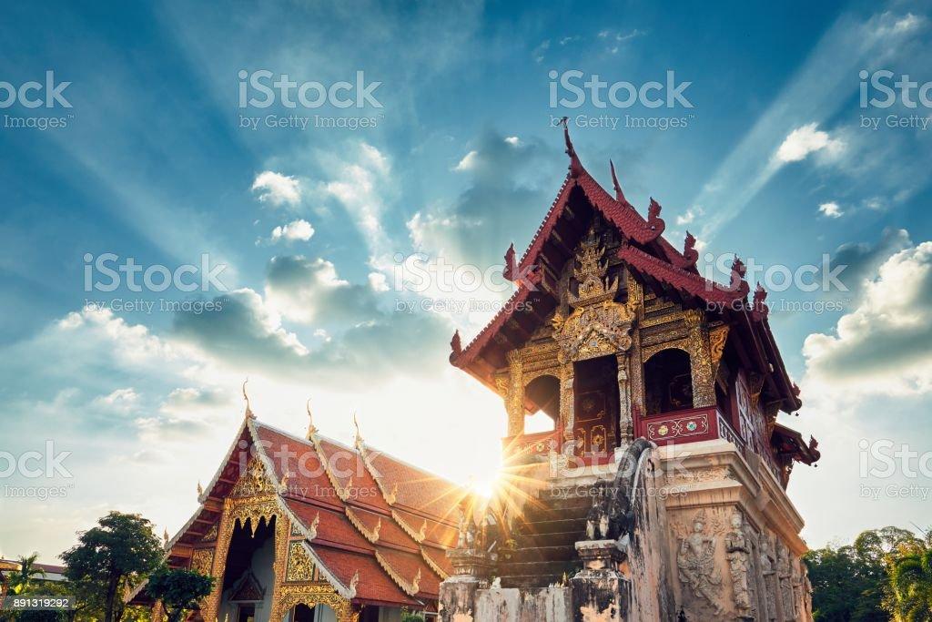 Buddhist temple at amazing sunset stock photo