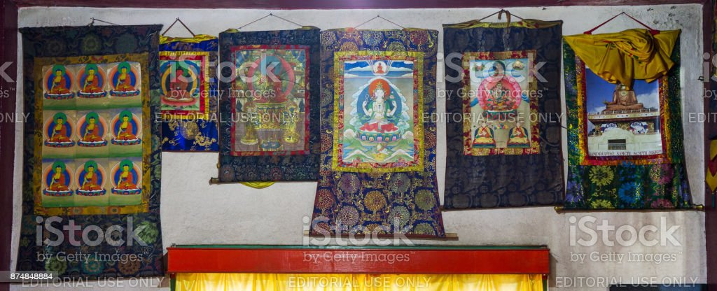 Buddhist thangkas - a Tibetan Buddhist paintings on cotton, or silk appliques - in a Rumtek monastery, Sikkim, India stock photo