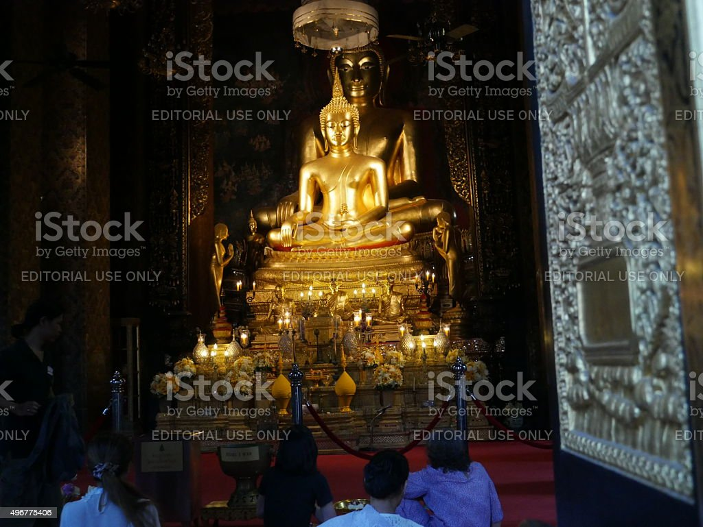 Buddhists in  Wat Bowon Niwet, Bangkok stock photo