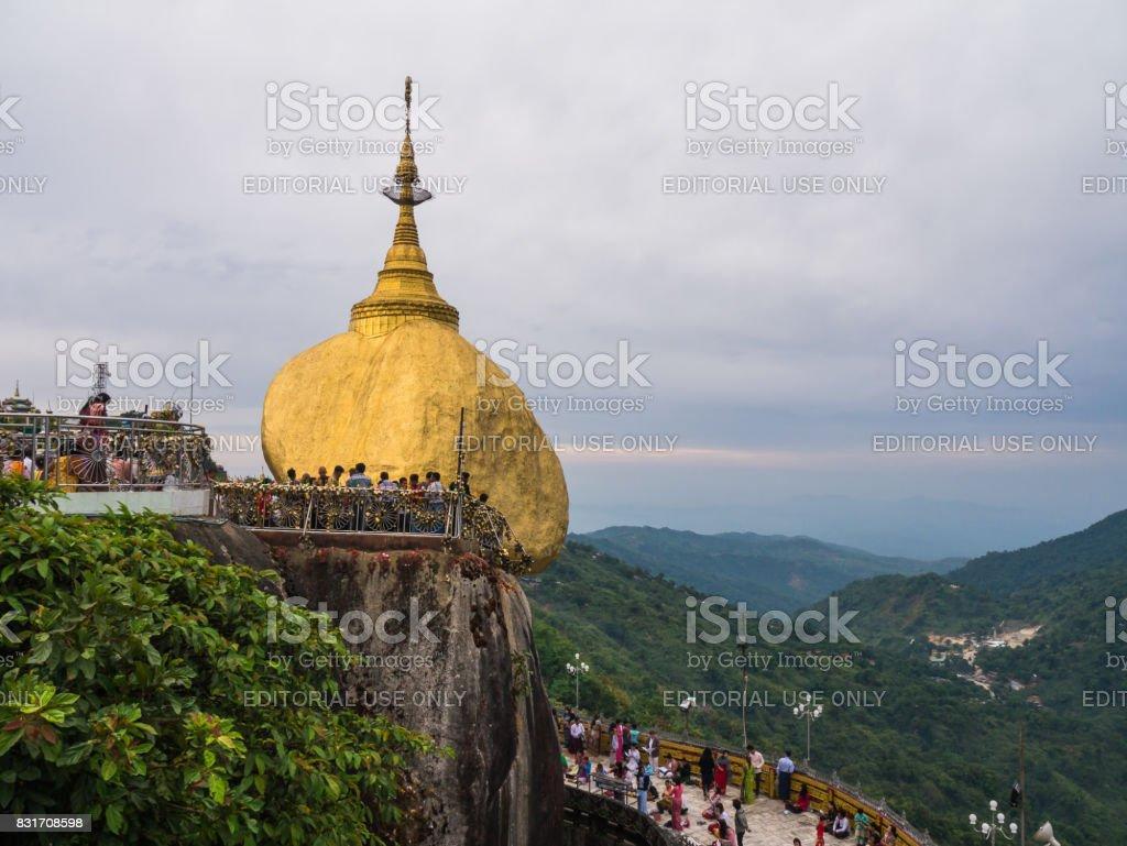 Buddhists pray at Kyaiktiyo Pagoda, Golden Rock stock photo