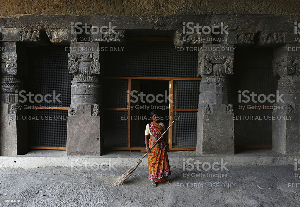 Buddihst statue is carved at the Ellora Caves royalty-free stock photo