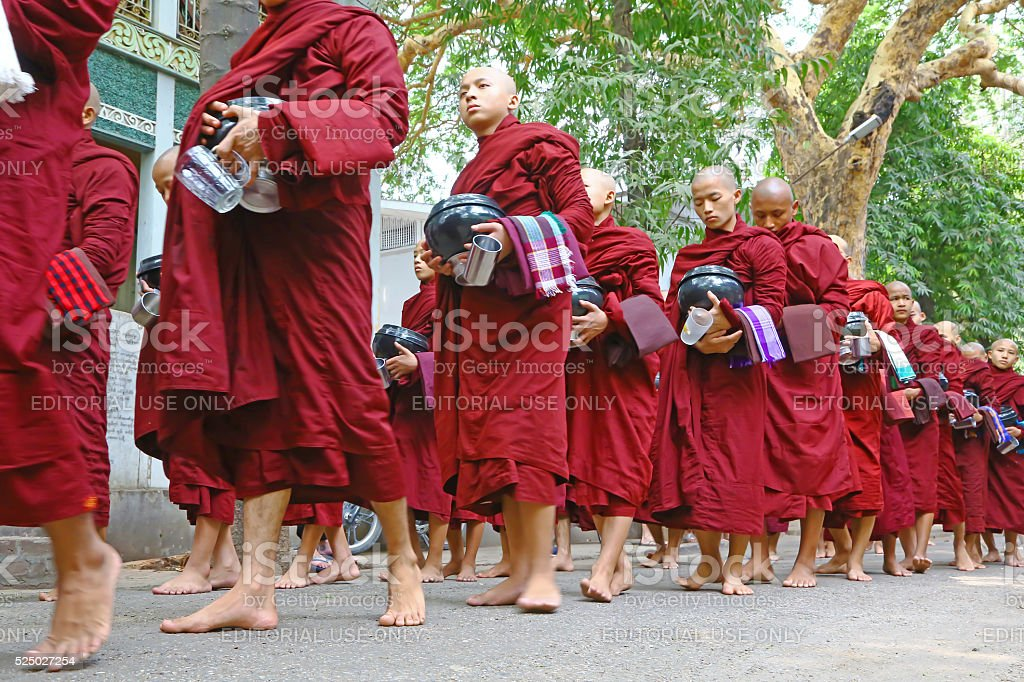 Buddist monks waiting for the meal, Myanmar stock photo