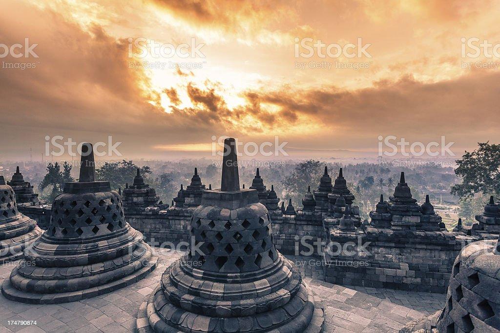 Buddist Temple of Borobudur at Sunrise in Java, Indonesia stock photo