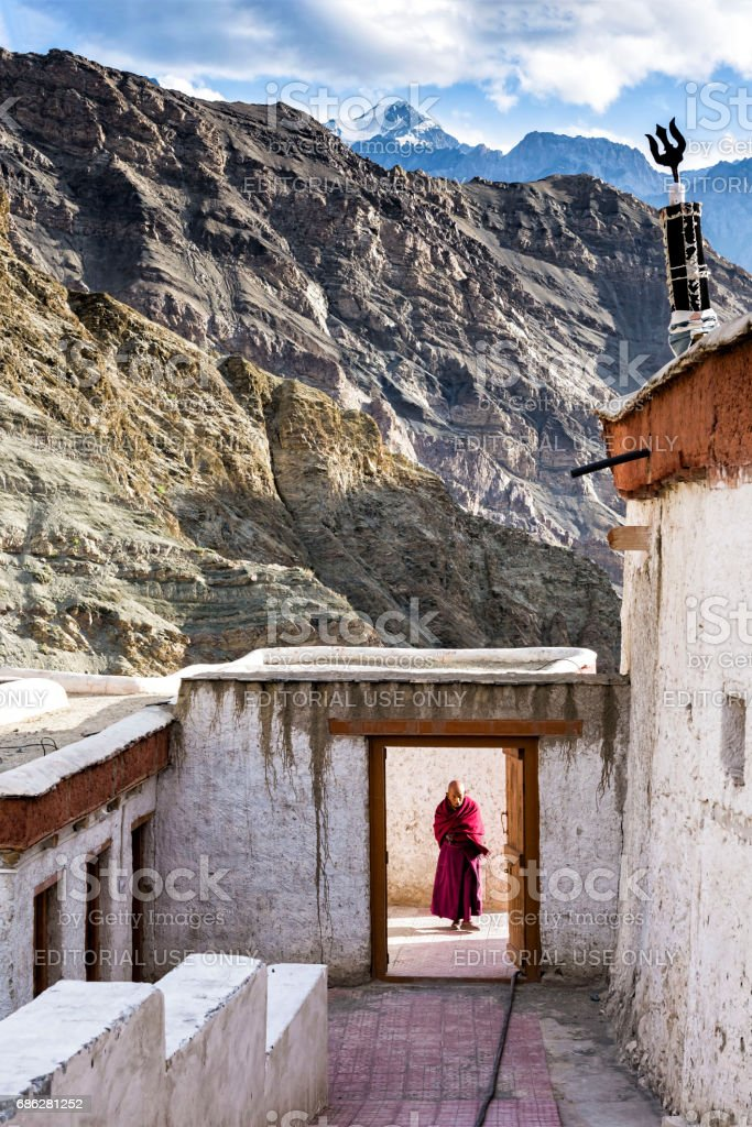 Buddisth monk at the entrance of Rizong Monastery stock photo