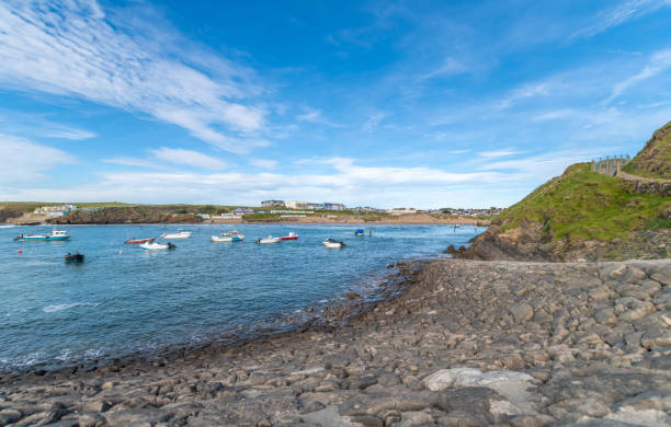 Bude bay and beach in Cornwall with boats in the water stock photo