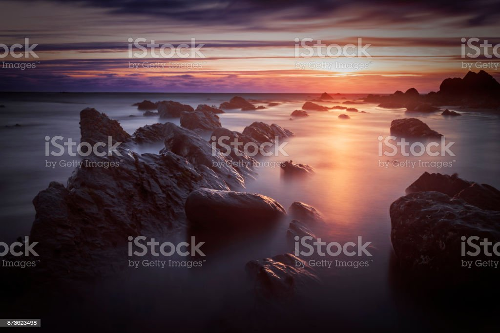 Bude, Cornwall, United Kingdom at sunset, beautiful seascape, sea crashing against rocks stock photo