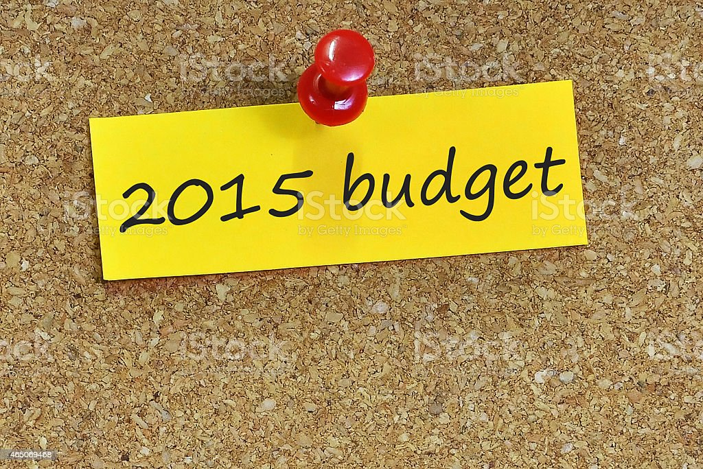 Budget 2015 on notepaper with brown cork background stock photo