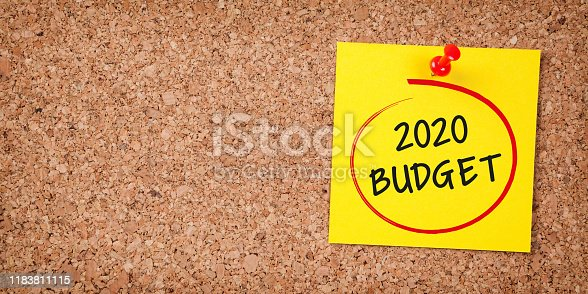 1170746979istockphoto Budget 2020 Word in Yellow Sticky Note on Cork Board 1183811115