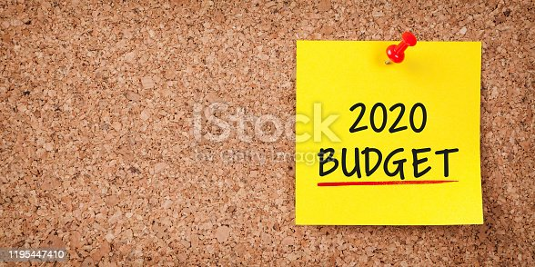 1170746979 istock photo Budget 2020 Word in Yellow Sticky Note on Cork Board 1195447410