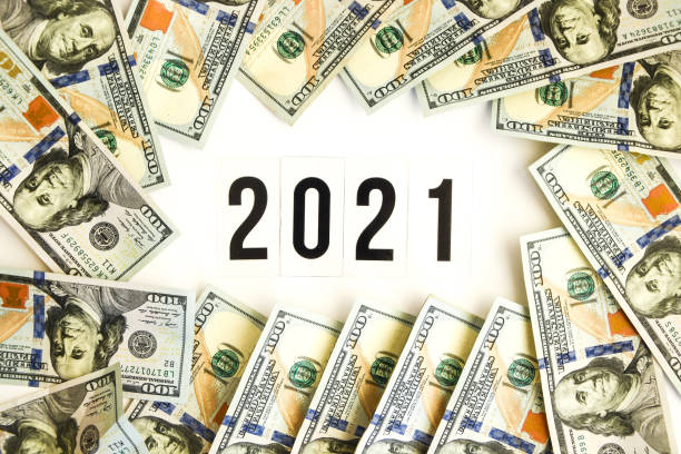 Budget 2021, the inscription on white space, on the background of dollar bills. New year budget concept. Business stock photo