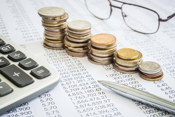 Budget and tax planning with raising coin stacks. stock photo