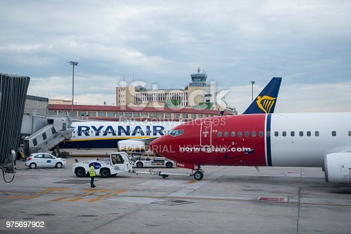 Two popular budget carriers, Ryanair and Norwegian, side by side at the Madrid Airport (May 22, 2018)