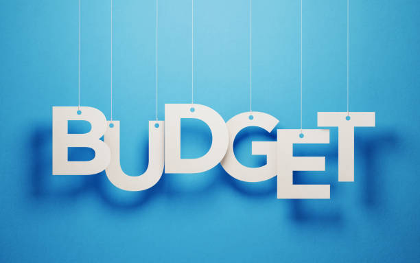 budget concept - white budget text with strings over blue background - home finances stock pictures, royalty-free photos & images