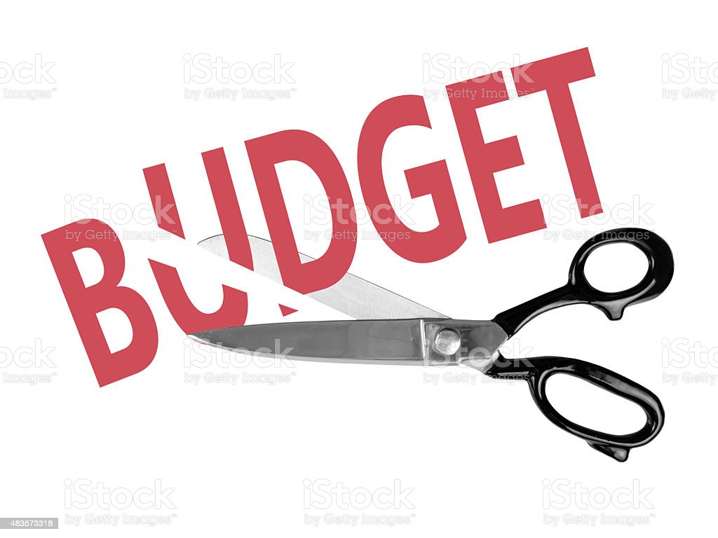 Budget cuts with scissors, isolated on white stock photo