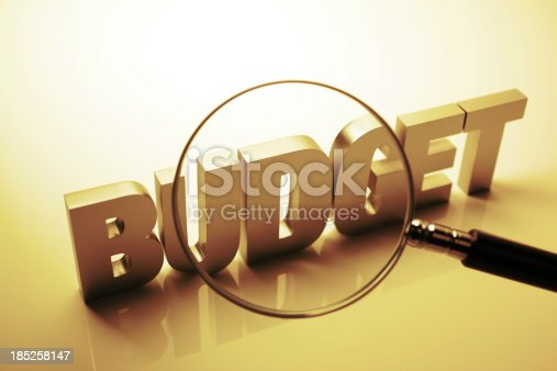 Finance concept. Looking through magnifying glass to block letter word - BUDGET.Similar images -
