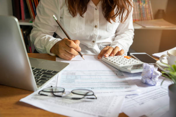 Budget planning Budget planning concept,Accountant is calculating company's annual tax.Calendar 2019 and personal income tax forms for those who have income under US law placed on office desk.This is the season to pay taxes. modern period stock pictures, royalty-free photos & images