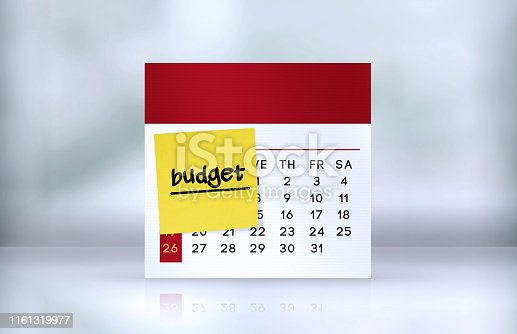 istock Budget Reminder Note Paper on The Desk Calendar 1161319977