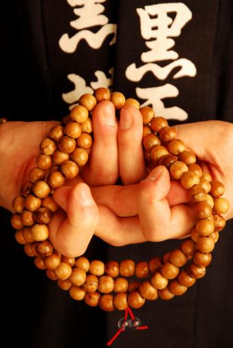 budhist monk holding beadssimilar images