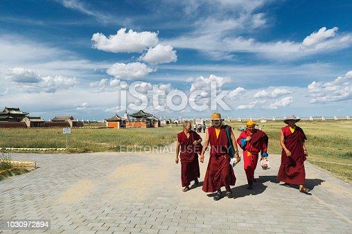 Karakorum, Mongolia - August 6, 2014: Budhist monks walk inside the Erdene Zuu monastery in Karakorum.