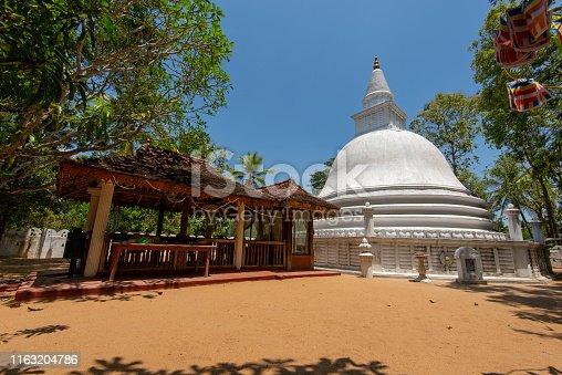 White dagoba or stupa at a buddhist temple in Sri Lanka.