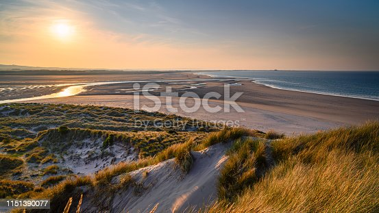 The mud flats at Budle Bay at low tide are part of Lindisfarne Nature reserve on Northumberland's AONB coastline