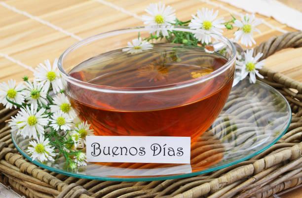 Buenos dias (good morning in Spanish) card, chamomile tea stock photo