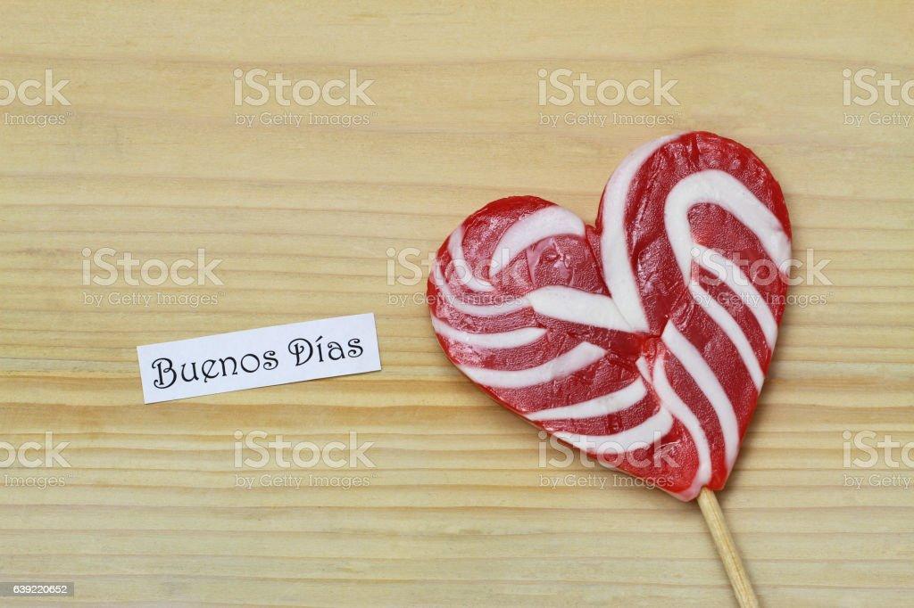 Buenos dias (good morning in Spanish) card, heart shaped lollipop stock photo