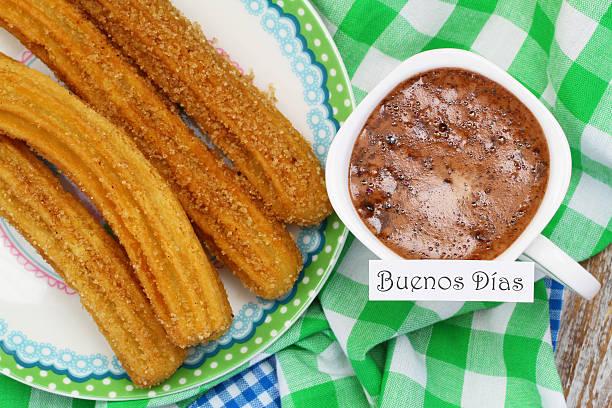 Buenos dias (Good morning in Spanish) card with Spanish churros stock photo