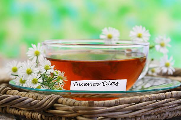 Buenos dias (Good morning in Spanish) with chamomile tea stock photo