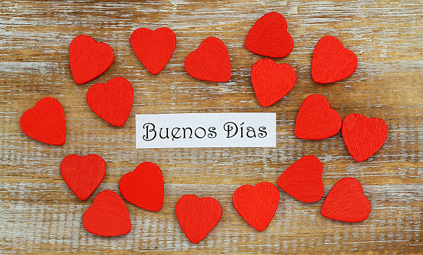 Buenos Dias (Good morning in Spanish) with little red hearts stock photo