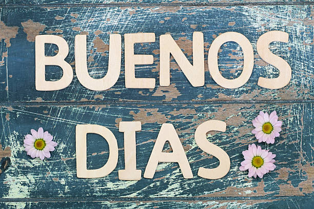 Buenos dias (good morning in Spanish) with pink daisies stock photo