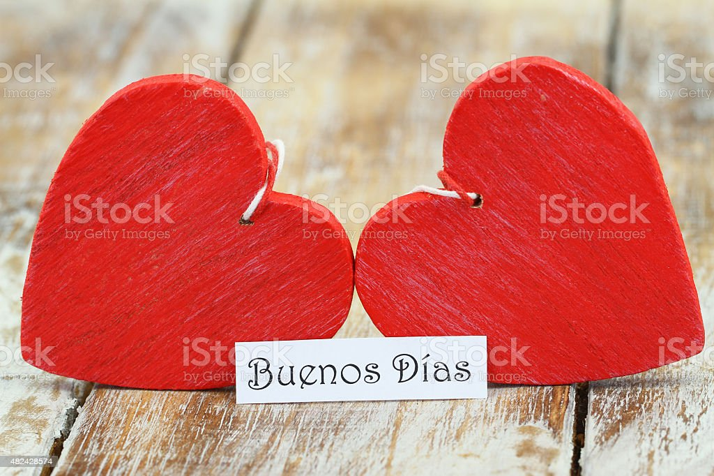 Buenos Dias (Good morning in Spanish) with two red hearts stock photo