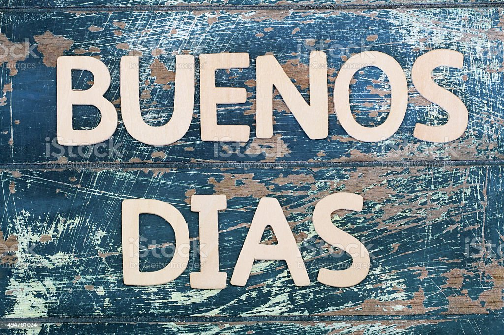 Buenos dias (good morning in Spanish) written on rustic wood stock photo
