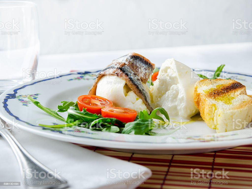 Antipasto bufala e alici stock photo