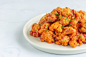 Barbecue Cauliflower Wings on a White Plate.  Healthy Baked Cauliflower Appetizer Photo.