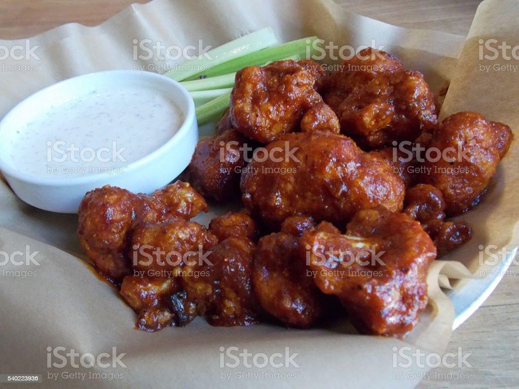 Buffalo Cauliflower Wings with Ranch Dressing stock photo