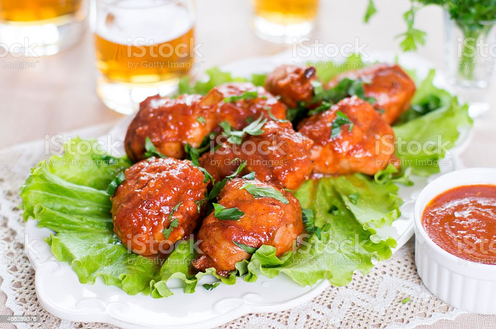 Buffalo chicken drumsticks with beer stock photo