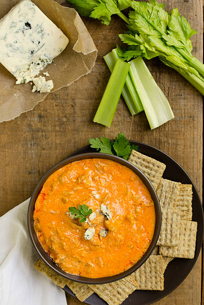 """Buffalo Chicken Wing Dip from Above """"Spicy Buffalo Chicken Wing Dip, made with chicken, blue cheese, cheddar cheese, hot sauce and celery.  Shot from directly above on a rustic wooden crate.Similar Images:"""" dipping sauce stock pictures, royalty-free photos & images"""