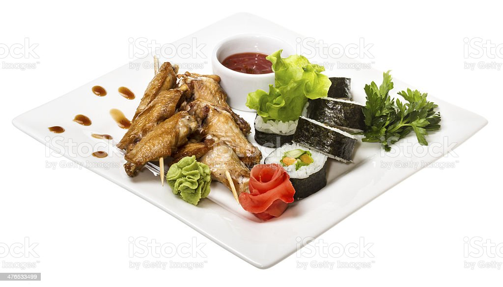 Buffalo chicken wings on plate with sushi royalty-free stock photo