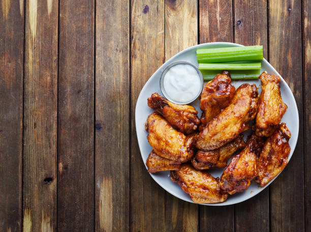 buffalo chicken wings with ranch and celery in overhead composition - ala di animale foto e immagini stock