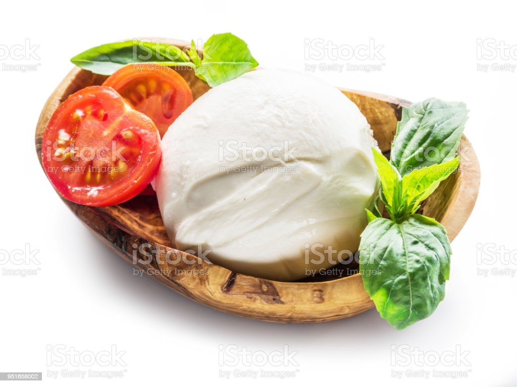 Buffalo mozzarella in the wooden bowl. stock photo
