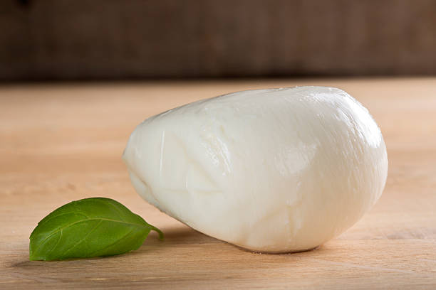 Buffalo mozzarella on wooden table stock photo