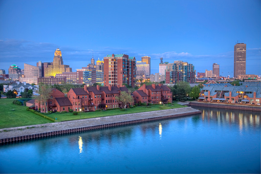 Downtown Buffalo skyline along the historic waterfront district at night. Buffalo is a city in the U.S. state of New York and the seat of Erie County located in Western New York on the eastern shores of Lake Erie. Buffalo is known for its close proximity to Niagara Falls, good museums and cultural attractions