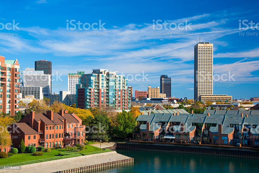 Buffalo skyline, elevated view with trees, houses, and waterway stock photo