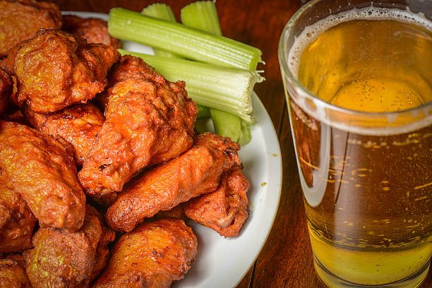 buffalo wings with celery sticks and beer - animal wing stock pictures, royalty-free photos & images