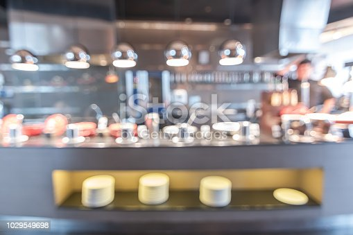 886308526istockphoto Buffet at hotel restaurant interior blur background with blurry open kitchen counter bar of food catering service business with chef staff cooking for breakfast, lunch or dinner meal 1029549698