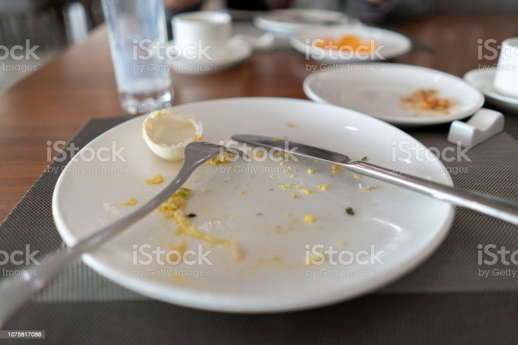 buffet breakfast: empty plate after eating stock photo