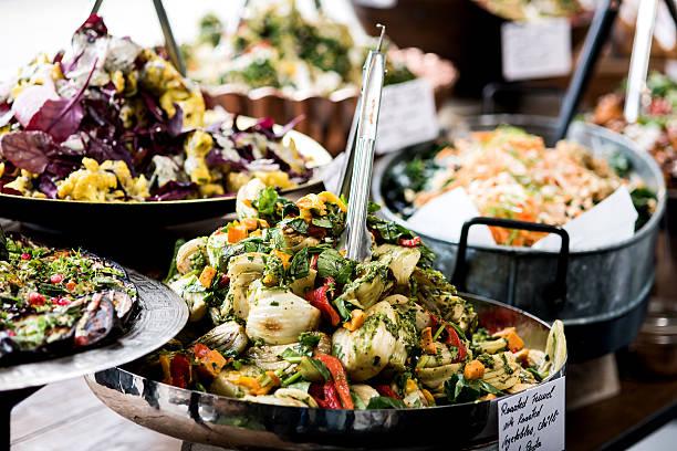 Buffet of assorted fresh salads stock photo
