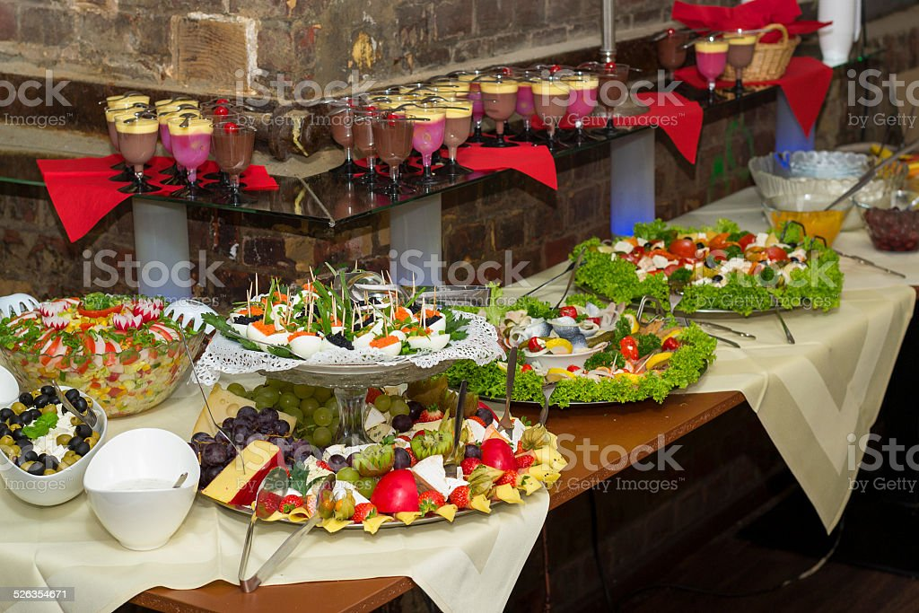Buffet of cold dishes and dessert stock photo